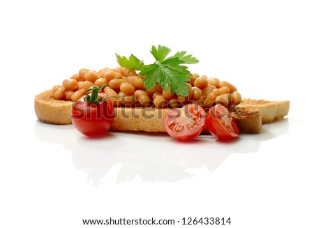 Studio macro of tasty baked beans on toast with garnish against a white background with soft shadows. Copy space. - stock photo