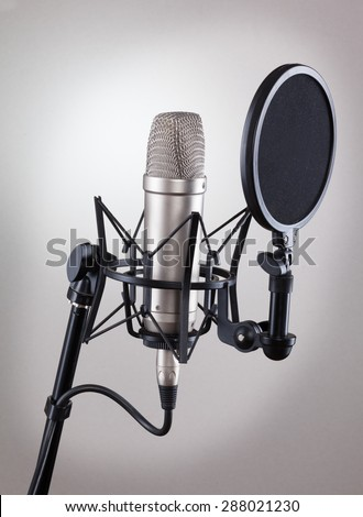 Studio microphone on a gray background. - stock photo