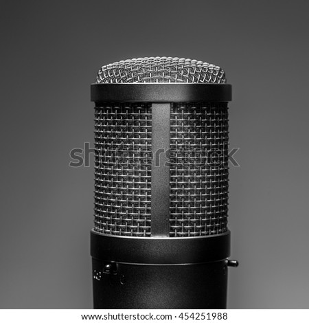 studio microphone on a gray background - stock photo