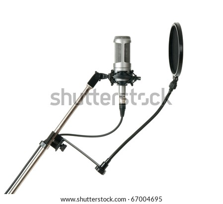 Studio microphone with pop filter, side view. Isolated on white background. - stock photo