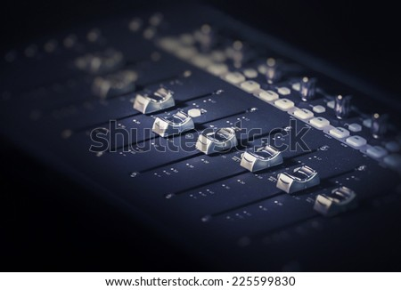 Studio music recording sliders bars knobs sound board - stock photo