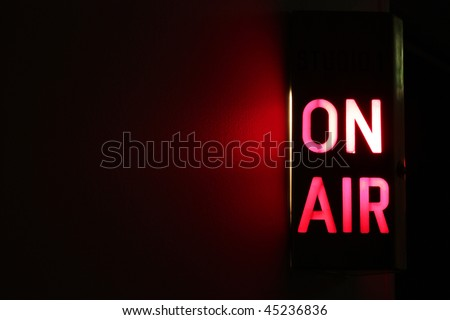 Studio On Air sign illuminated with glowing copy space