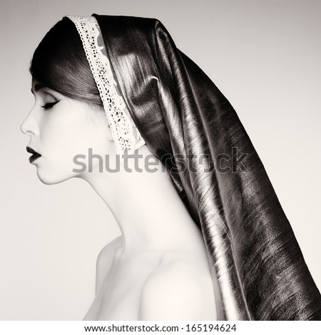 Studio photo of a beautiful woman in retro style. - stock photo
