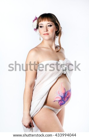 Studio photo of a young pregnant woman - stock photo