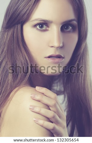 Studio photo of a young woman / girl with color grading. High key perfume style model shot. Not cropped; suitable for further reproduction.
