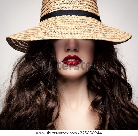 Studio photo of a young woman with accessories in a rustic style. - stock photo