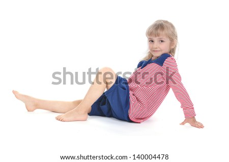 Studio photo of adorable little girl in a striped blouse and knickerbockers