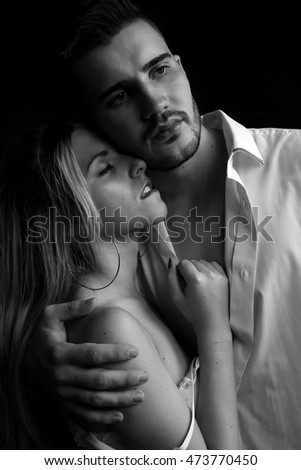 Studio photo of beautiful couple in elegant clothes. love story, Valentine's day