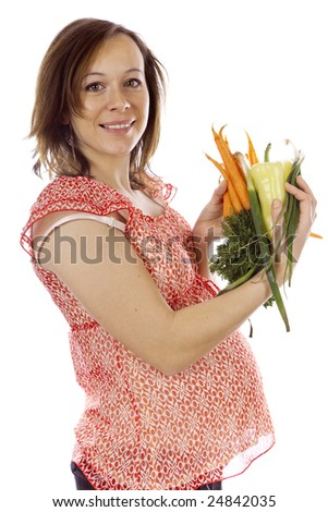 studio photo of beauty pregnant woman with vegetables
