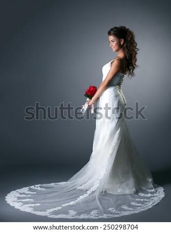 Studio photo of majestic bride in elegant dress - stock photo