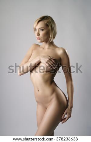 Studio photo of nude blonde with bob haircut - stock photo