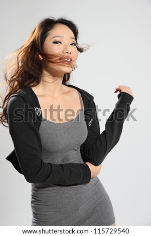 studio photo of one young Asian woman - stock photo
