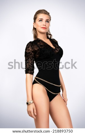 Studio photo of sexy woman in black lingerie. Photo-shoot executed in the studio.