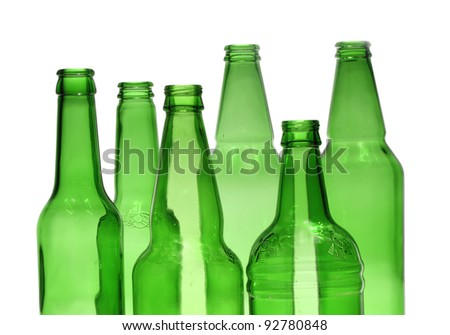 studio photo of some empty green beer bottles over white background on different concept themes/some green bottles