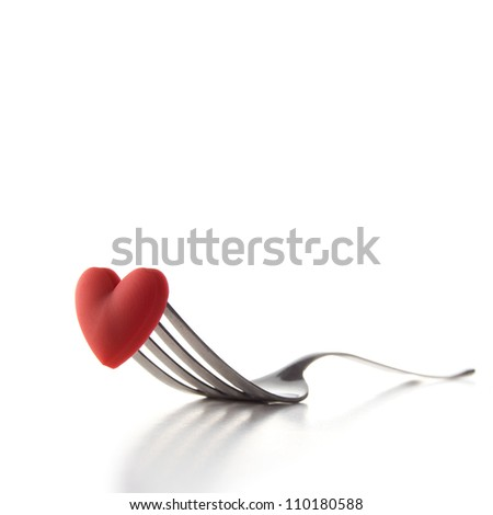 "Studio photograph of a concept image for ""I Love Food"" or Valentine's Day dining, isolated on white. Copy space. Square Crop. - stock photo"