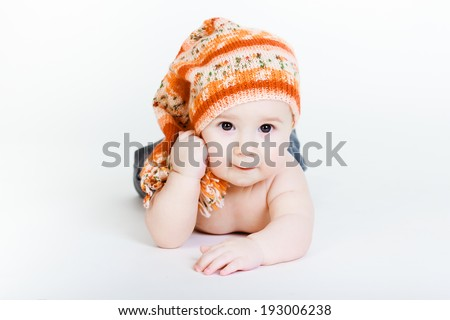 Studio photography. Little baby boy in a knitted hat posing - stock photo