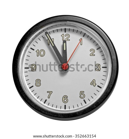 studio photography of a clock showing five minutes to twelve - stock photo