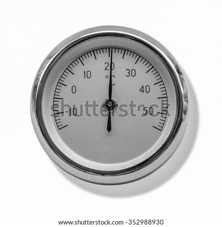 studio photography of a round metallic thermometer isolated on white, with clipping path