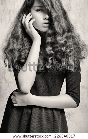 Studio photography of a young woman in urban urgent things.