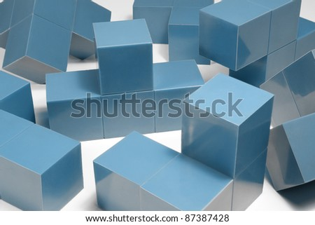studio photography of some blue cubic elements in light back