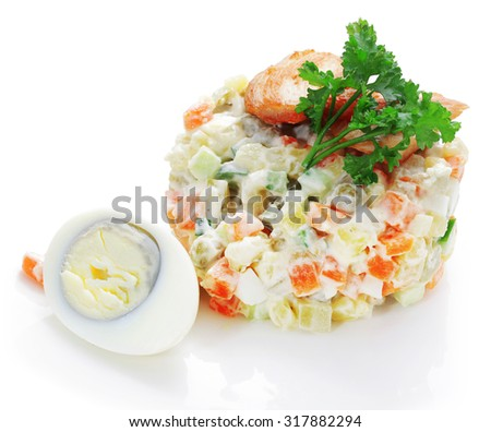 studio photography Rusian cold salad named Olivier or Stolichniy on white background with shadows