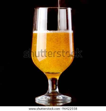 Studio photography showing a glass of beer