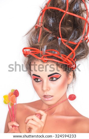 Studio photos - sexy emotional girl with art make-up color and red wire on the head on white background