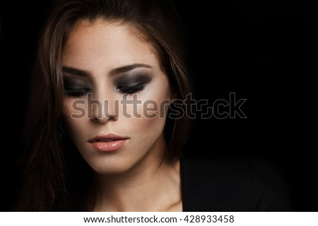 Studio photoshoot female model with smokey style makeup