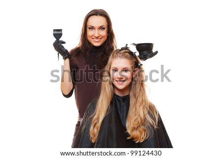 studio picture of hairdresser doing hair dye. isolated on white - stock photo