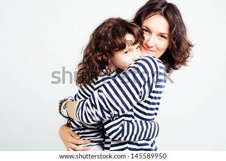 Studio picture of happy mother with her son - stock photo