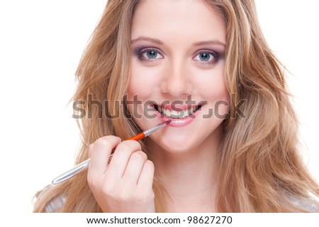 studio picture of young smiley woman doing visage. white background