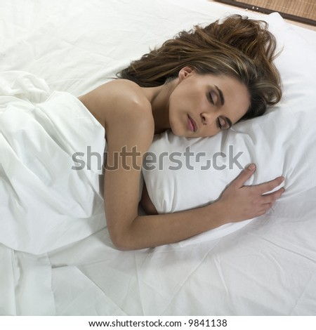 studio portrait isolated on white background of a beautiful caucasian woman sleeping