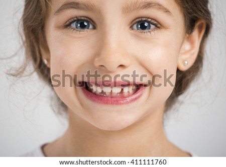 Studio portrait of a beautiful and happy girl smiling