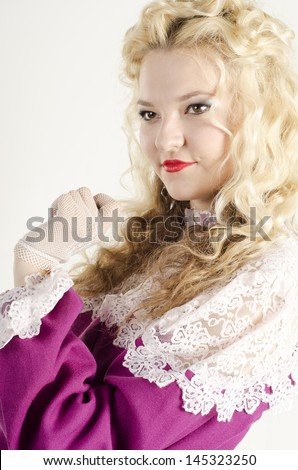 Studio portrait of a beautiful, attractive  girl dressed like an old fashionable lady on white background