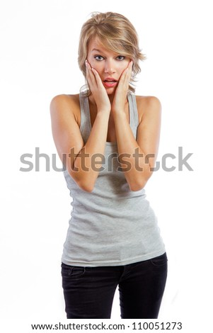 studio portrait of a beautiful blonde girl with the emotion of surprise