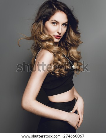 Studio portrait of a beautiful fashion girl in profile