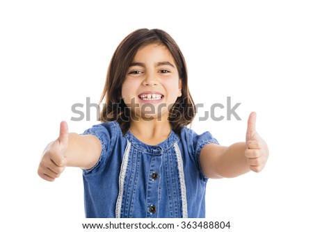 Studio portrait of a beautiful girl with thumbs up, isolated over white background