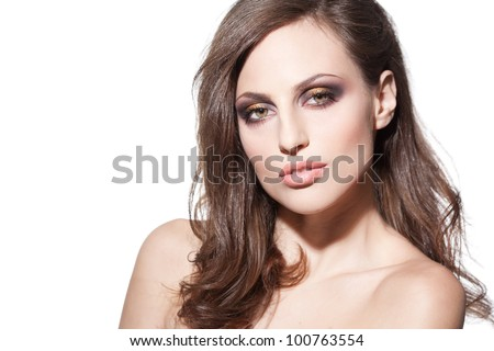 Studio portrait of a beautiful sexy brunette woman with perfect makeup - stock photo