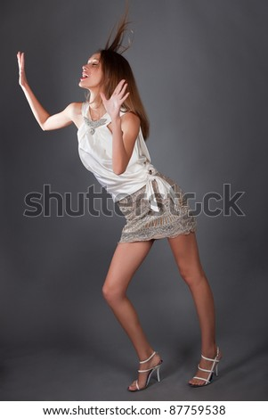 Studio portrait of a beautiful sexy young woman - stock photo