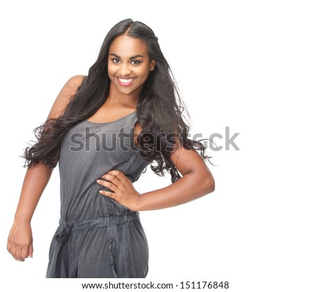 Studio portrait of a beautiful woman with long hair smiling on isolated white background - stock photo