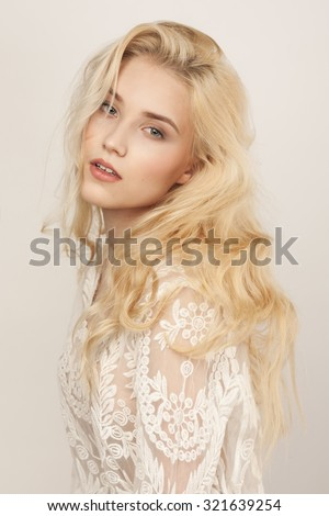 Studio portrait of a beautiful young blond woman - stock photo