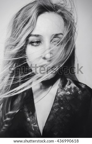 Studio portrait of a beautiful young blonde woman - stock photo