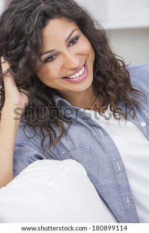 Studio portrait of a beautiful young Latina Hispanic woman smiling  - stock photo