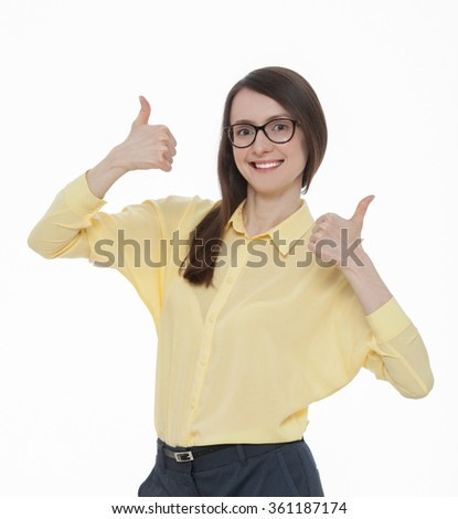 Studio portrait of a beautiful young woman showing a thumbs up sign, white background - stock photo