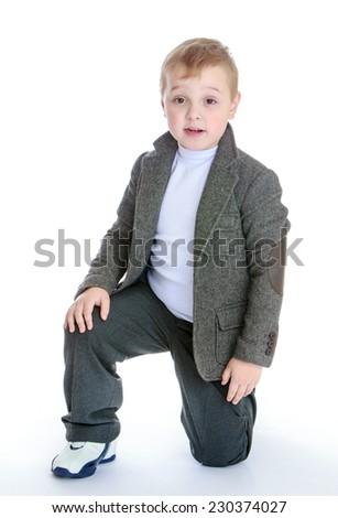 Studio portrait of a boy in a gray suit.baby fashion concept - little boy in a gray suit.