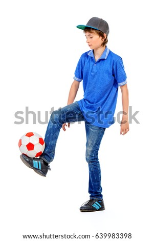 Studio portrait of a boy teenager with football. Isolated over white background.