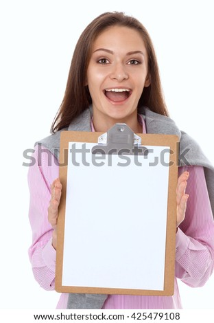 Studio portrait of a confident young female professional holding a clipboard .
