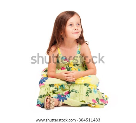 Studio portrait of a cute emotional young brunette girl.