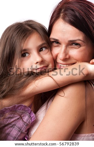 Studio portrait of a cute little girl hugging her mother - stock photo