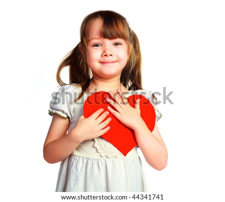 studio portrait of a cute little girl with  a Valentine card in her hands - stock photo